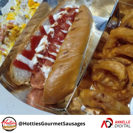Sausage in a bun with extra relish on the side and onion rings from Hotties Gourmet Sausages