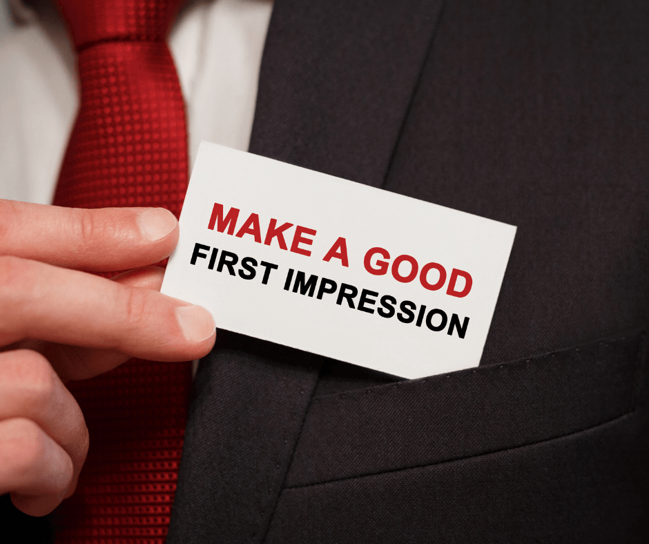 man inserting calling card labeled make a good first impression
